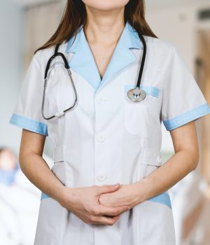 woman in white button up shirt and blue stethoscope